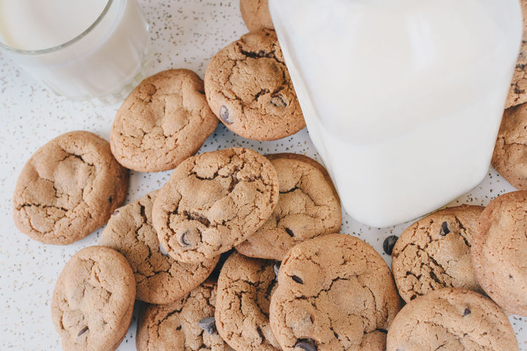 Close-up of cookies and milk bottle