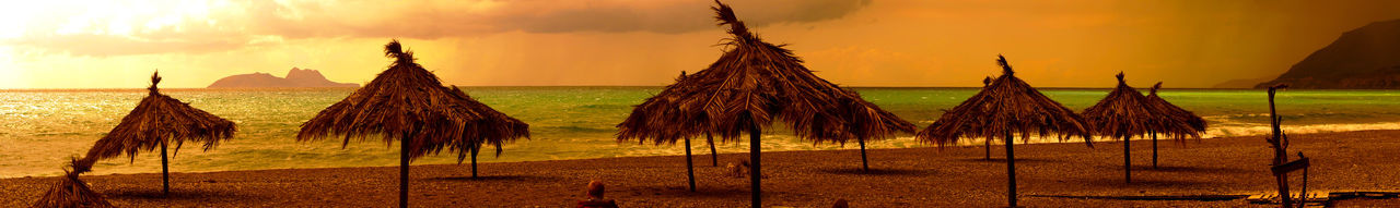 Beach Photography Beauty In Nature Crete Greece Kokkinos Pyrgos Beach Winter Nature No People Outdoors Panoramic Photography Sand Scenics Sea Sunset Tranquility Travel Destinations Tree Umbrellas Wild