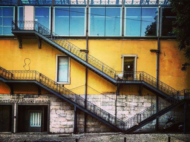 Façade Warehouse Studio Stairs Windows Yellow Colorful Wrought Iron Lisboa Lisbon Portugal Streetphotography Mmaff From My Point Of View Eye4photography  EyeEm Gallery Taking Photos Hello World Showcase June
