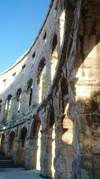Pula Colosseum Pula Croatia History Through The Lens  Arches Light And Shade Architecture Blue Sky