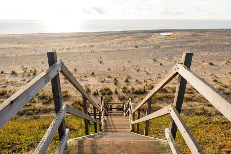 wooden steps heading down over the beach and sand dunes at Lowestoft Suffolk Beach Beauty In Nature Cloud - Sky Day Environment Horizon Horizon Over Water Land Nature No People Outdoors Sand Scenics - Nature Sea Sky Tranquil Scene Tranquility Water Wood - Material