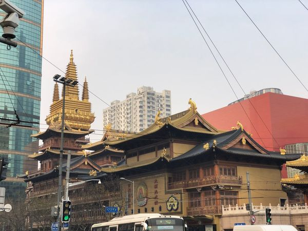 Jing'an Temple Shanghai Low Angle View Gold Colored Gold Jing'an Temple Jingan Temple In Shanghai EyeEm Selects Architecture Building Exterior Built Structure City Skyscraper Tower Day Outdoors Cable No People Cityscape Travel Destinations Sky Tall Modern