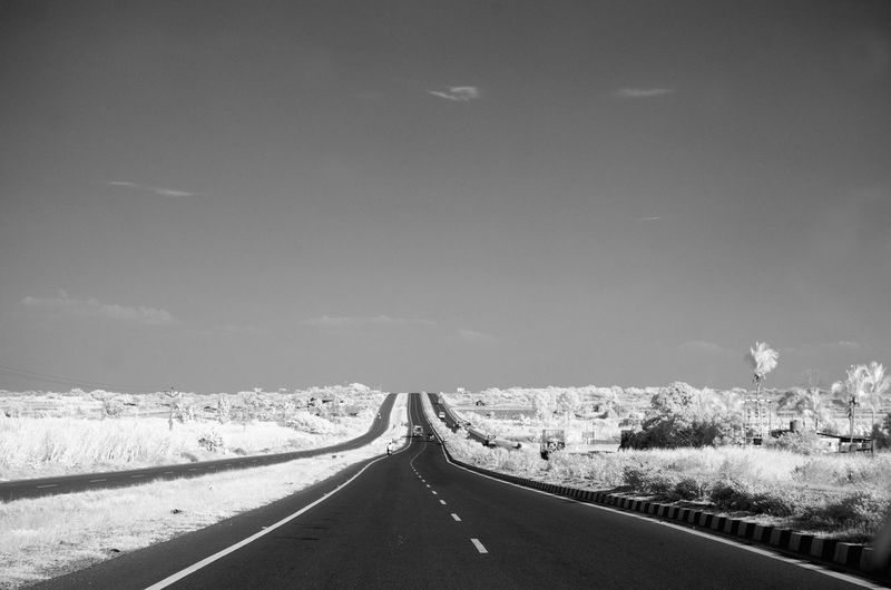 Digital Composite Image Of Country Road Amidst White Landscape Against Sky