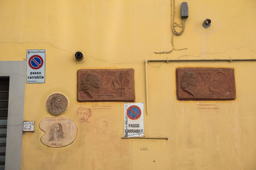 Communication Day Florence Network No People Outdoors Plaques Signs Technology Text Wall Wires Yellow