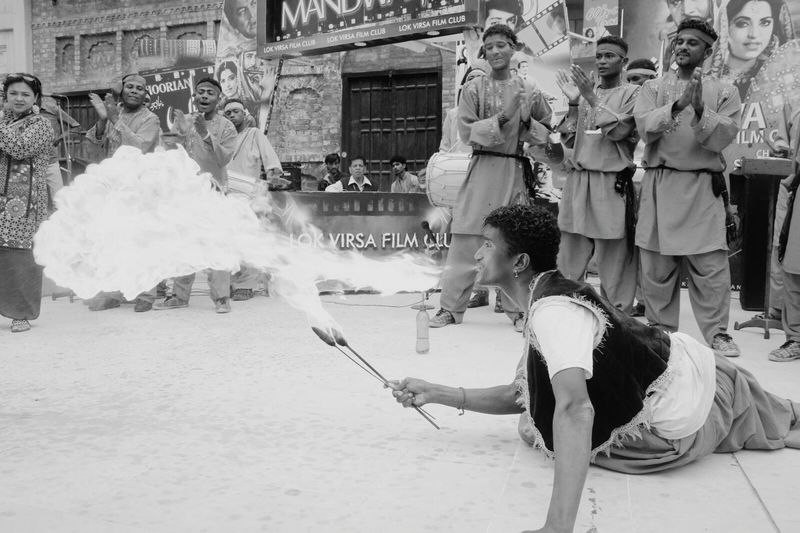 Black And White Friday A guy is playing with fire at very ease. Adult People Men Smoke - Physical Structure Real People Heat - Temperature Spraying Women Togetherness Outdoors Day EyeEmNewHere Fun Dancing Elégance Performing Arts Event Performance Arts Culture And Entertainment