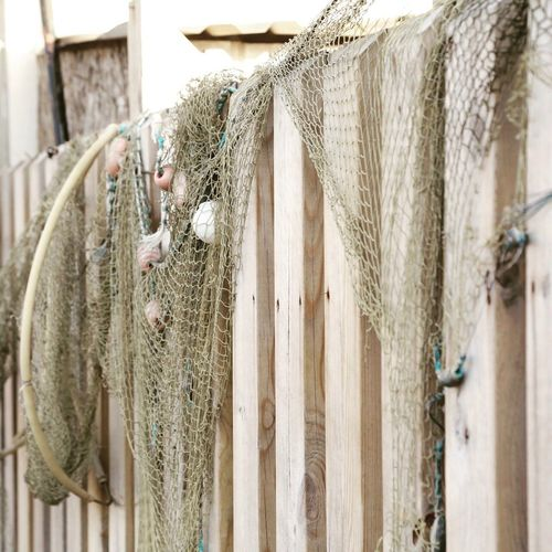 Fishing Net Fishingnet Fishing Net Fishingtools Background Wooden Texture Wooden Fence Wooden Post Wooden Structure Outdoors Photograpghy  Floating Floats Livestock No People Day Built Structure Drying Sheep Outdoors Close-up Nature Architecture
