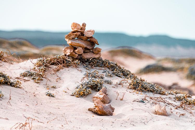 Stone rock stacks on tropical beach, boa vista, cape verde
