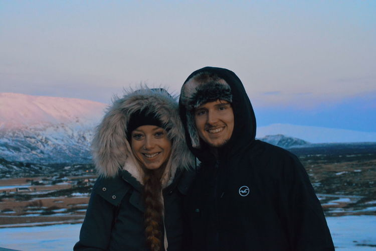 Warm Clothing Portrait Snow Cold Temperature Togetherness Winter Smiling Looking At Camera Friendship Mountain Snowing Winter Coat Mid Adult Couple Knit Hat Blizzard Ski Holiday Hooded Shirt Hood - Clothing Snowfall
