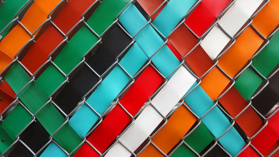 Multi colored ribbon through fencing