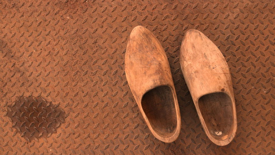 High angle view of shoes on flooring