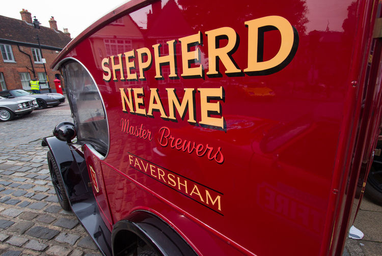 Shepherd Neame,Faversham Car Show Shepherd Neame Vivid International Getty Images Travel Destinations Tourism Garden Of England Brewery Beer Spitfire Ice Cream Austin Van EyeEm Gallery Text Western Script Communication Land Vehicle Mode Of Transportation Red Transportation Capital Letter Sign Car No People Motor Vehicle Day City Information Close-up Street Information Sign Accidents And Disasters Architecture Wheel