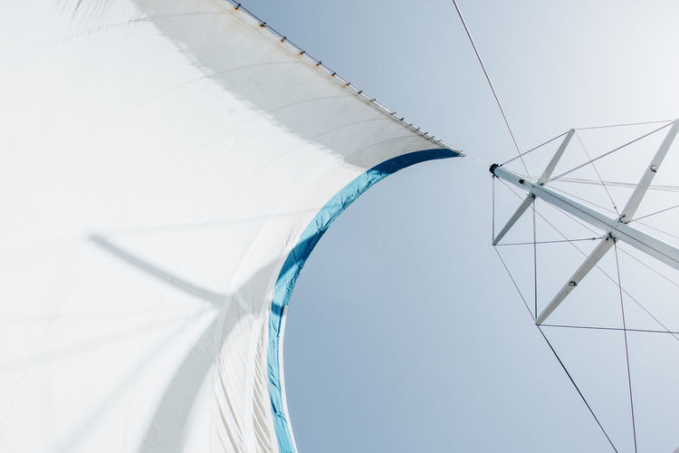 Low angle view of a boat sail against sky