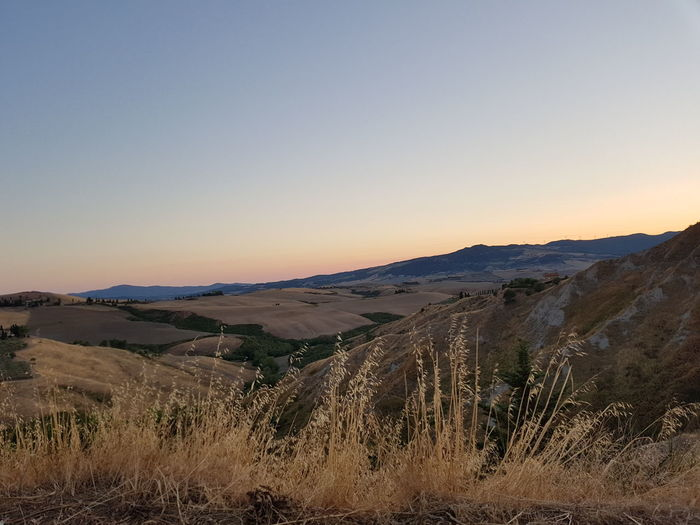 sunset EyeEm Selects Toscana Tuscany Art is Everywhere Amazing Freedom Art Landscape Scenics Nature Sunset Outdoors Desert Beauty In Nature Sky Tranquility Tranquil Scene Day Mountain Sand No People Travel Destinations Clear Sky Arid Climate Sand Dune Agriculture