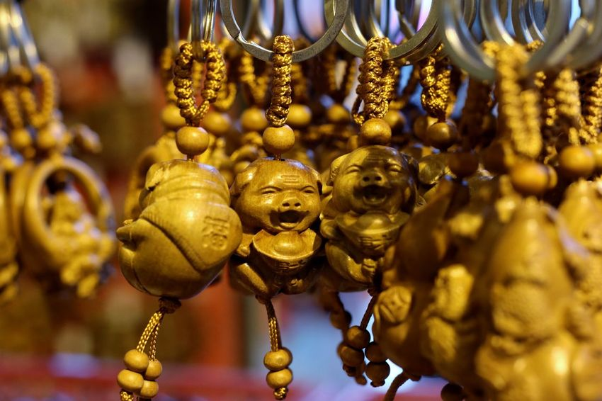 Happy pigs! Art And Craft ASIA China Chinese Culture Chinese Zodiac Close-up For Sale Gold Colored Hanging Happiness Happy Pigs Hong Kong Keyring Large Group Of Objects Market No People Pig Pigs Religion Retail  Sculpture Smile Smiles Souvenir Tourism