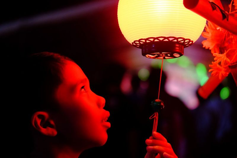 Real People Childhood Illuminated Child Focus On Foreground Lighting Equipment One Person Leisure Activity Lifestyles Portrait Close-up Indoors  Hanging Red Headshot Chinese Lantern Profile View Lantern Side View Nature