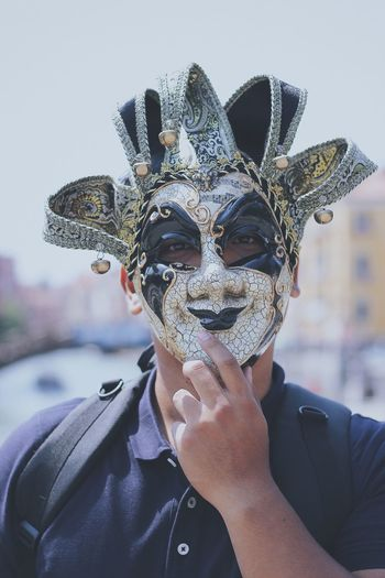 Portrait Of Man Wearing Venetian Mask