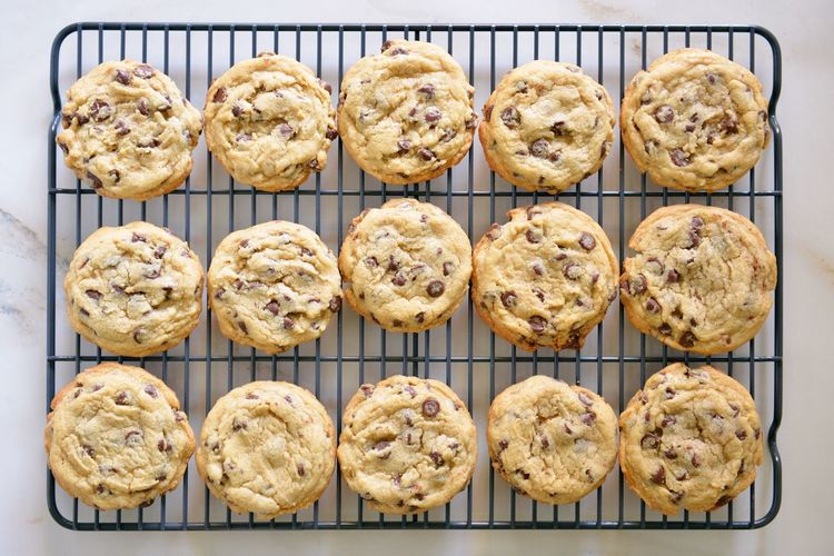 Directly above shot of chocolate chip cookies on cooling rack at table