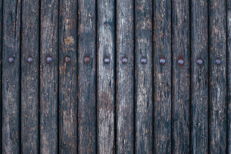 parallel wooden planks texture Plank Planks Wooden Texture Background Surface Backdrop Old Bench Park Textured  Panel Construction Design Decor Desk Natural Abstract Timber Rough Dried Material Vintage Hardwood Vertical Board Wood Exterior Dark Pattern Nature Structure Table Wall Grunge Dirty Rustic View Space Retro Old-fashioned Rivet Style Gray Front Metal Forged Detail