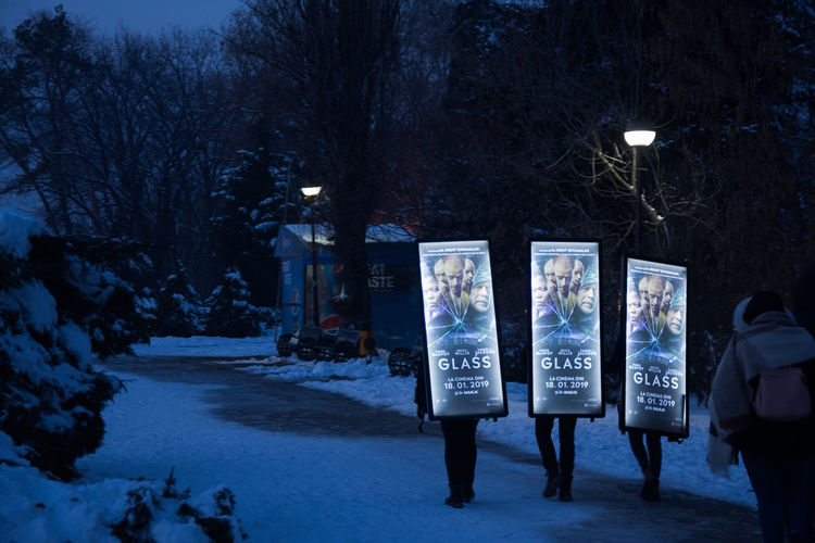 Three billboards, or the ads going back home Advertising Living Advertisement Advertisement Illuminated Cold Temperature Winter Real People Street Photography Three 3 Boardman Walking Going Home From Work Herastrau Park Billboard Humanity Meets Technology Streetwise Photography
