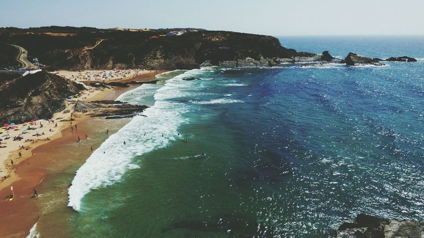 EyeEm Selects Sea Water Beach Nature Outdoors Scenics Day Sky Horizon Over Water Rock Formation People On The Beach Waves Sand Summer Vibes Summer 2017 EyeEm Selects Summer Views Summer Memories 🌄 Summer Vacation Zambujeira Do Mar Portugal Landscape Nature Clear Sky
