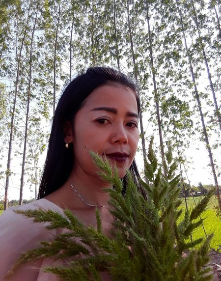 Woman Only Women Human Body Part TreePorn Sitting Full Length Plant Sky Looking At Camera Tree And Sky Real People Field Cereal Plant Beauty In Nature Close-up Palm Tree Thailand🇹🇭 2018 EyeEmNewHere Tranquility Beauty❤