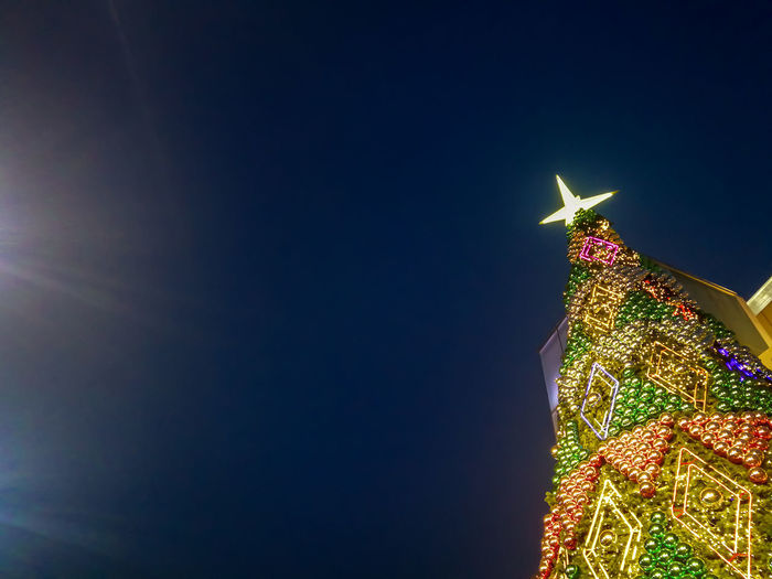 Christmas Lights New Year Architecture Building Building Exterior Built Structure Celebration Christmas Christmas Decoration Christmas Decorations Christmas Ornament christmas tree Copy Space Decoration Flare Holiday Illuminated Light Lighting Equipment Low Angle View Night Outdoors Sky Skyscraper Travel Destinations