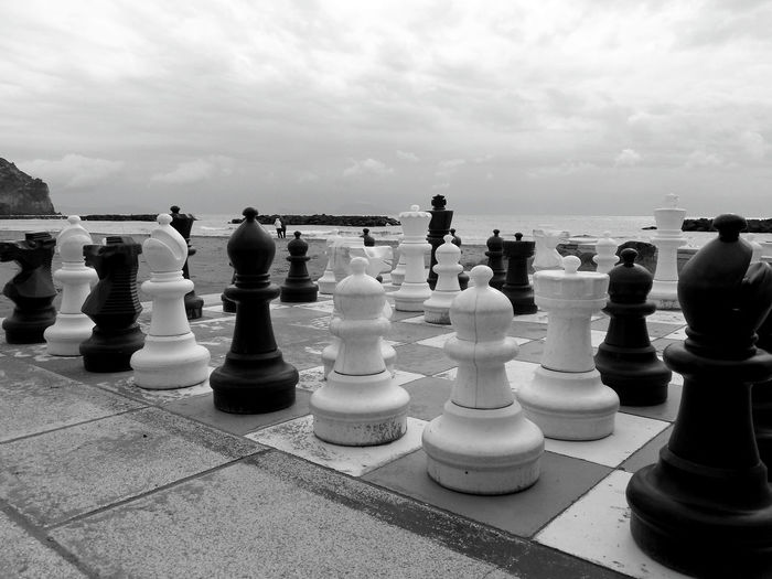 Full frame shot of chess board on sea against sky
