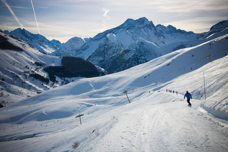 French Alps Alps Mountains Snow Winter Snowy Snowcapped Mountain Mountain Cold Temperature Beauty In Nature Scenics - Nature Mountain Range Sky Leisure Activity Adventure Sport Real People White Color Environment Covering Winter Sport Non-urban Scene Unrecognizable Person Skiing ❄ Ski