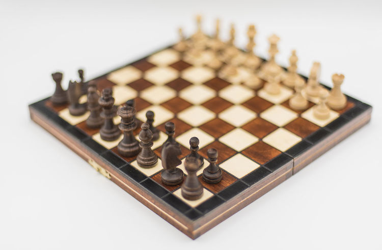 Arrangement Board Game Challenge Checked Pattern Chess Chess Board Chess Piece Close-up Competition Day Indoors  Intelligence King - Chess Piece Knight - Chess Piece Leisure Games No People Pawn - Chess Piece Queen - Chess Piece Strategy White Background Wood - Material