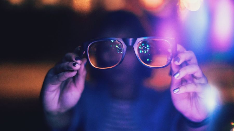Person Holding Glasses