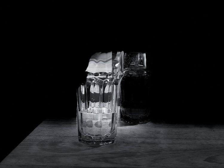 Glass in the dark Glass Black Background No People Indoors  Studio Shot Water Drinking Glass Freshness Perfume Sprayer Close-up Day