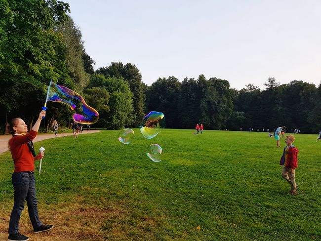 Fun Leisure Activity Sope Bubble Togetherness Spraying Enjoyment Playing Motion Bubble Wand Tree People Outdoors Real People Day Large Group Of People Men Adult Only Men Nature Sky Adventures In The City Adventures In The City