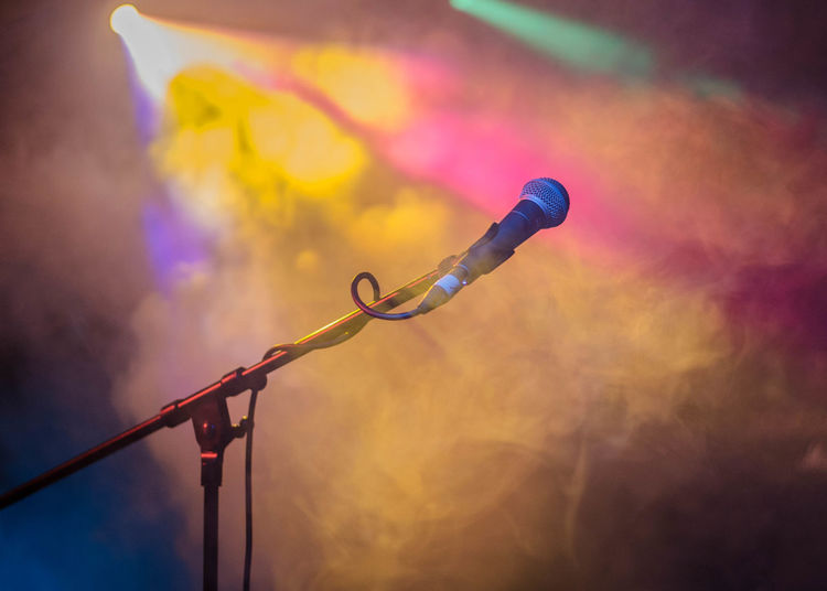 Low Angle View Of Microphone In Spotlights At Stage