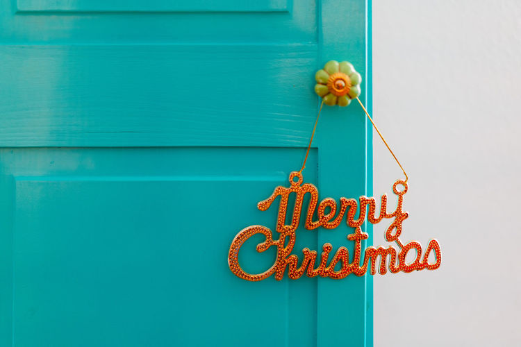 Christmas Decoration Christmas Decoration Christmas Festive Decoration No People Text Communication Day Blue Western Script Close-up Sign Built Structure Door Entrance Yellow Outdoors Architecture Green Color Wall - Building Feature Metal Wood - Material Art And Craft Building Exterior Turquoise Colored