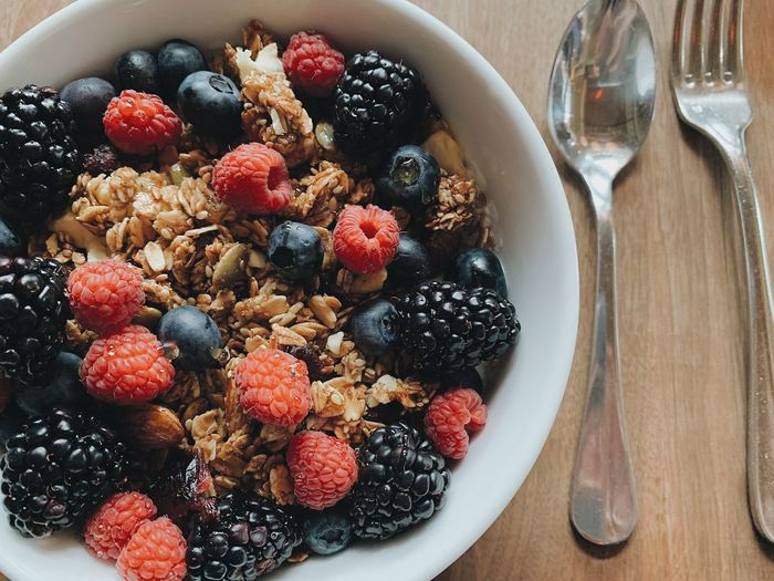 Berries Granola Yogurt Healthy Eating Food And Drink Food Fruit Berry Fruit Freshness Wellbeing Eating Utensil Still Life Meal Indoors  Bowl Raspberry Directly Above Blueberry Spoon High Angle View Table Breakfast Kitchen Utensil