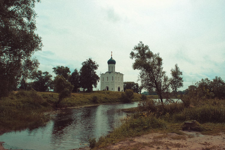 Autumn landscape in retro style. White church on the river, in the countryside Church Architecture Autumn🍁🍁🍁 Building Exterior Country Life Countryside Day Landscape Nature No People Outdoors Plant Religion River Sky Travel Destinations Tree Water