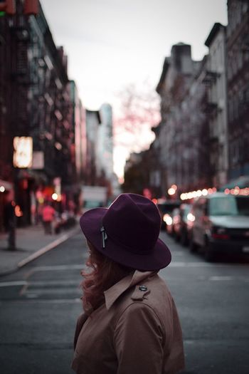 Side View Of Woman Wearing Purple Hat On Street In City