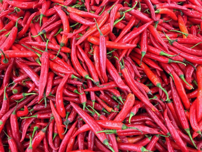 Full frame shot of red chili peppers for sale at market stall