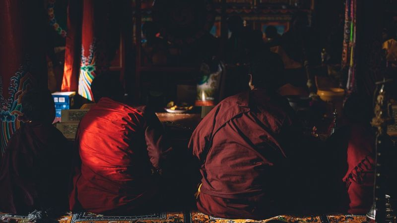 Religion Spirituality Men Indoors  Real People Night Full Length Women Illuminated Adult People Adults Only Lama Lama Temple