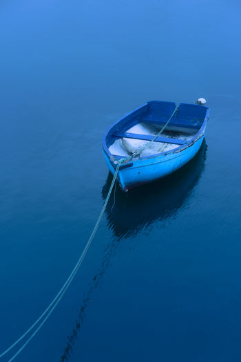 High angle view of boat moored in lake