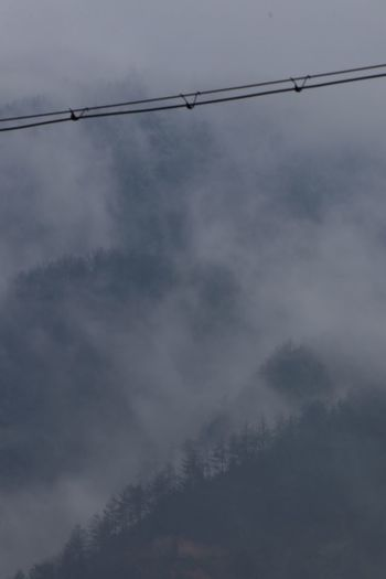 Empty Mountain Fog Fog Cable Sky Electricity  Cloud - Sky Low Angle View No People Power Line  Tree Scenics - Nature Telephone Line Day Dusk Outdoors