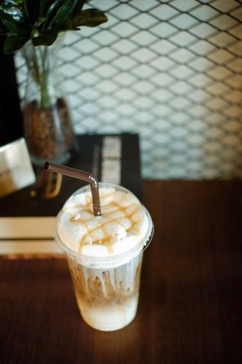 Drink Food And Drink Refreshment Drinking Glass Glass Food Table Cold Temperature Coffee Iced Coffee Frozen Focus On Foreground Coffee - Drink Indoors  Drinking Straw Household Equipment Freshness Straw Still Life Close-up