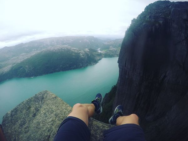 Sitting on the edge of Priekestolen in Norway. Looking down the Lysefjord. Personal Perspective Scenics Mountains Norway Lysefjord Priekestolen Water Nature Outdoors Perspectives On Nature Explore