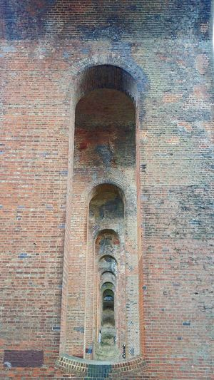 Arch after arch, after arch... Under The Bridge Bridge Bridges Bridgesaroundtheworld Bridges_aroundtheworld Mill Hill East Taking Photos Architecture Postcode Postcards Lines And Patterns Lines And Design Lines And Angles Brick Brick Wall Brick Bridge Arch Arches Architecture_collection Architectural Detail Better Look Twice Deceptively Simple The Architect Colour Pallete Your Design Story Dramatic Angles