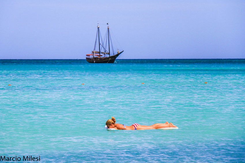 #Aruba #Blue #paradise #Relaxing #summer Beach Beauty In Nature Blue Clear Sky Day Full Length Horizon Over Water Leisure Activity Men Nature Nautical Vessel One Person Outdoors Real People Scenics Sea Tranquil Scene Tranquility Vacations Water