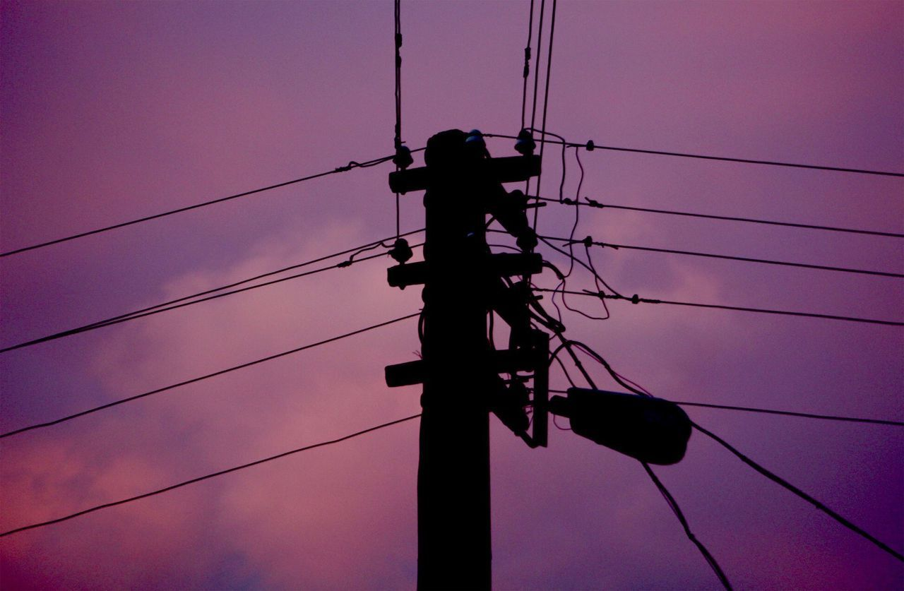 LOW ANGLE VIEW OF SILHOUETTE ELECTRICITY PYLON AGAINST SKY AT DUSK