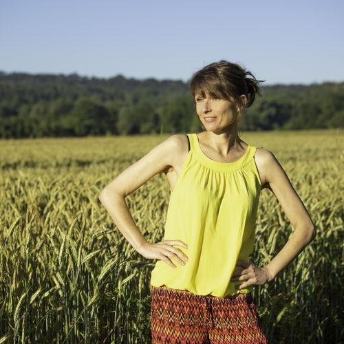 Woman standing in field