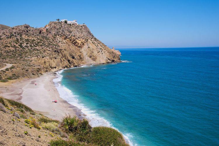 En la costa de Mojácar, Almería Mediterranean  SPAIN Almería Tower Andalucía Water Clear Sky Sea Beach Sand Blue Cliff Summer Wave Rock - Object Seascape Rocky Coastline