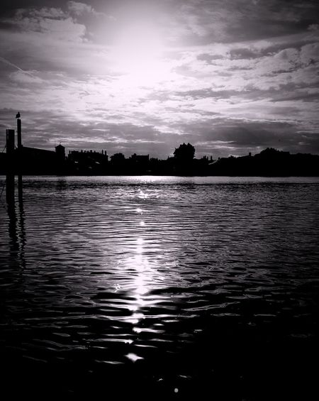 Water Silhouette Reflection Cloud Rippled Tranquility Scenics River Tranquil Scene Beauty In Nature Outdoors Day Sun Contrast Blackandwhite Tint Illuminated High Contrast Bnw Bright Black And White Photography Heavy Edits Light And Shadow No People