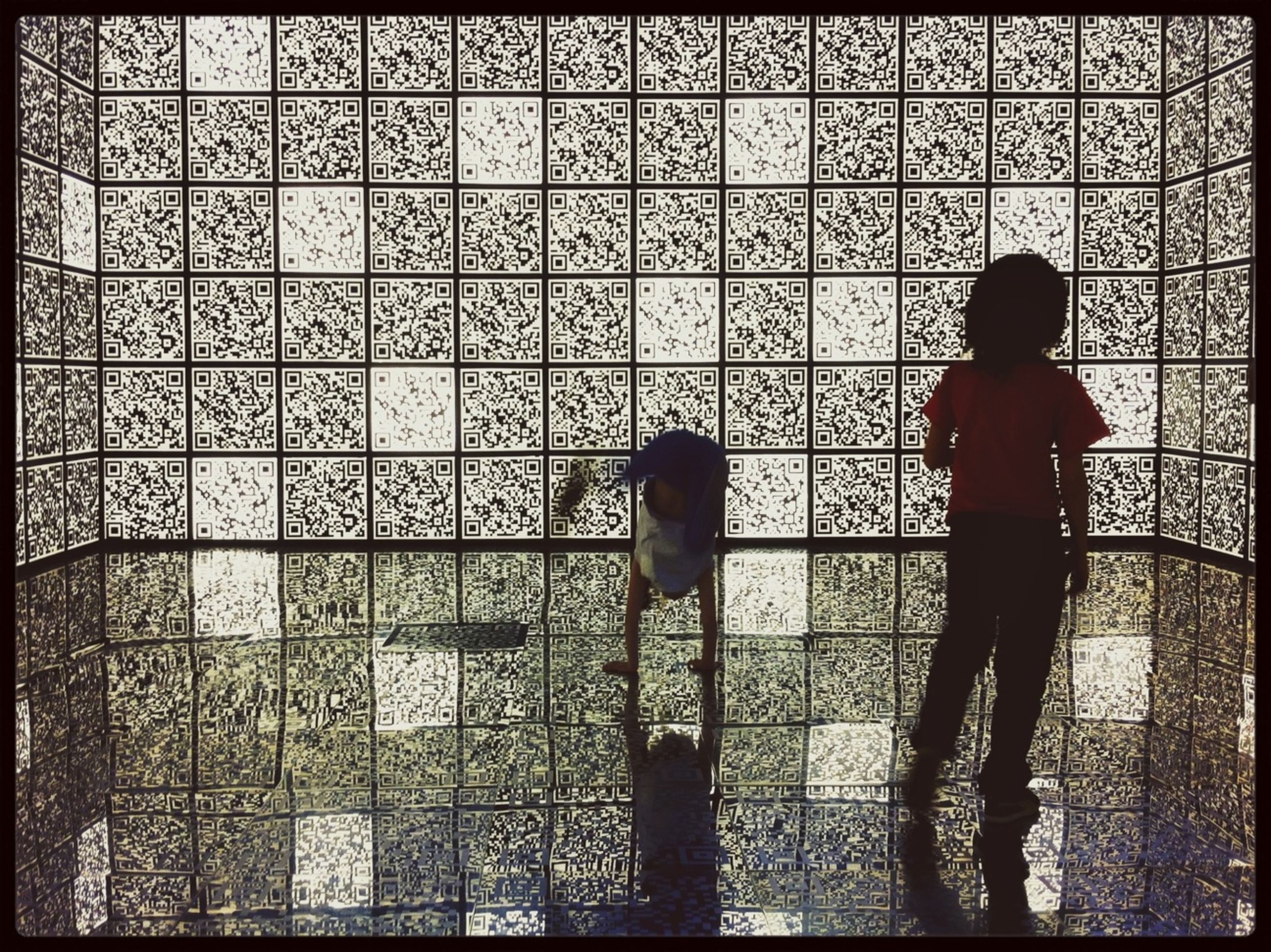 transfer print, auto post production filter, indoors, silhouette, architecture, built structure, wall - building feature, men, window, pattern, lifestyles, full length, standing, day, leisure activity, wall, shadow, rear view
